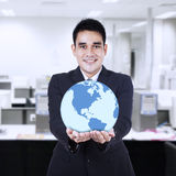 Asian businessman holding globe Stock Photography
