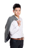 Asian businessman holding jacket Royalty Free Stock Images