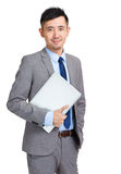 Asian businessman holding laptop. Isolated on white Royalty Free Stock Photography