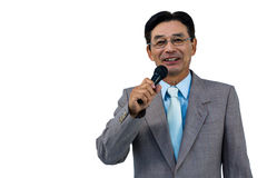 Asian businessman holding microphone Royalty Free Stock Photo