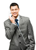 Asian businessman holding phone Stock Images