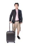 Asian businessman holding smart travel bag Stock Images
