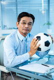 Asian businessman holding soccer ball Stock Photography