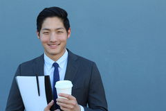 Asian Businessman Holding To Go Coffee Cup and Folder Royalty Free Stock Photo