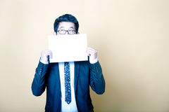 Asian businessman holding white blank sign Royalty Free Stock Photography