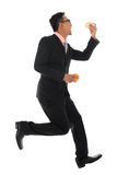 Asian businessman in hurry eating bun. Full body Asian businessman in hurry eating bun and running, isolated on white background Royalty Free Stock Photography