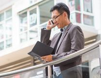 Asian businessman with jacket Stock Image