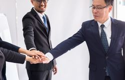 Asian business join hands success for dealing,Team work to achieve goals,Hand coordination. Asian businessman join hands success for dealing,Team work to achieve royalty free stock photography