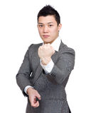 Asian businessman with kungfu pose Royalty Free Stock Photography