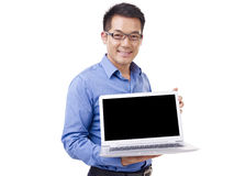 Asian businessman with laptop computer Stock Photography