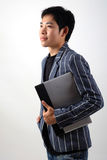Asian businessman with laptop Stock Images