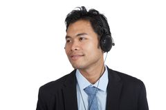 Asian businessman listen to music with headphones Royalty Free Stock Images