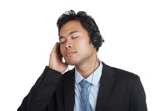 Asian businessman listen to music with headphones Stock Photography