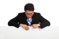 Asian businessman look down behind blank banner Stock Photography