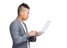 Asian businessman look at laptop computer Stock Photos