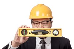 Asian businessman look at a spirit level Stock Photography
