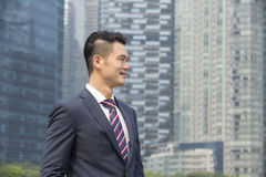 Asian businessman looking away. Royalty Free Stock Photography