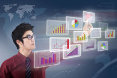 Businessman looking chart Royalty Free Stock Photos