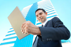 Asian businessman looking at tablet pc Royalty Free Stock Photography