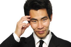 Asian businessman making decision. In black suit Stock Photo