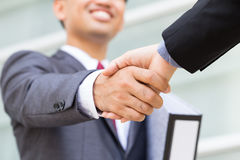 Asian businessman making handshake with smiling face Stock Image