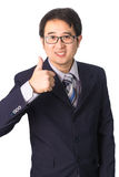 Asian businessman making thumbs up with a Smiling, Isolated on w Royalty Free Stock Image