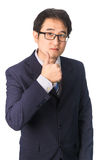 Asian businessman making thumbs up with a Smiling, Isolated on w Royalty Free Stock Photos