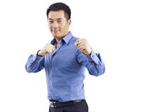 Asian businessman in martial art posture Stock Photos