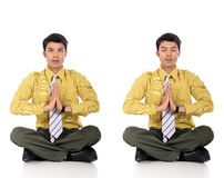 Asian Businessman meditating yoga Royalty Free Stock Photo