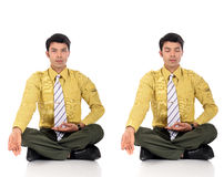 Asian Businessman meditating yoga Stock Photography