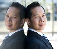 Asian businessman with mirror reflection Stock Photos