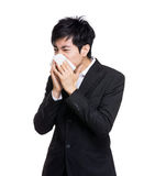 Asian businessman with nose allergy Royalty Free Stock Images