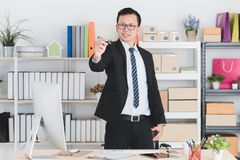 Asian businessman at office stock photos