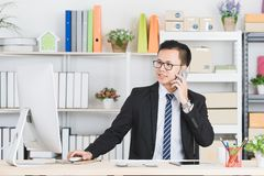 Asian businessman at office royalty free stock images