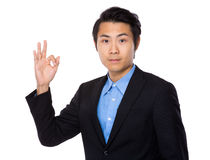 Asian businessman with ok sign geature Royalty Free Stock Photography