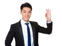 Asian Businessman with ok sign gesture Royalty Free Stock Image