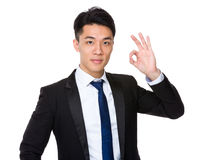 Asian businessman with ok sign gesture Stock Images