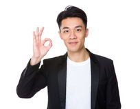 Asian businessman with ok sign gesture Stock Photography