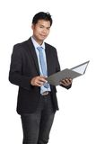 Asian businessman open a folder and smile Stock Photo