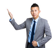 Asian businessman with open hand palm Stock Photo