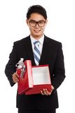 Asian businessman open red gift box Stock Image