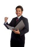 Asian businessman open a report and hold his fist  Stock Images