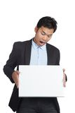 Asian businessman panic look at a blank sign Royalty Free Stock Photography
