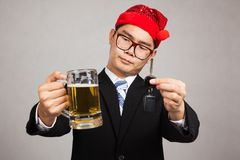 Asian businessman with party hat decide drink or drive Royalty Free Stock Images