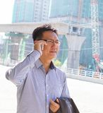 Asian businessman on the phone Royalty Free Stock Photography