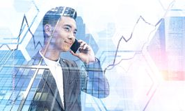Asian businessman with phone, graph stock photography