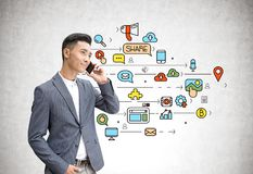 Asian businessman on phone, social media Stock Image