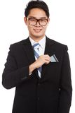 Asian businessman pick a card from his pocket Stock Photo