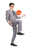 Asian businessman playing soccer Stock Image
