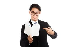 Asian businessman point to a book Stock Image